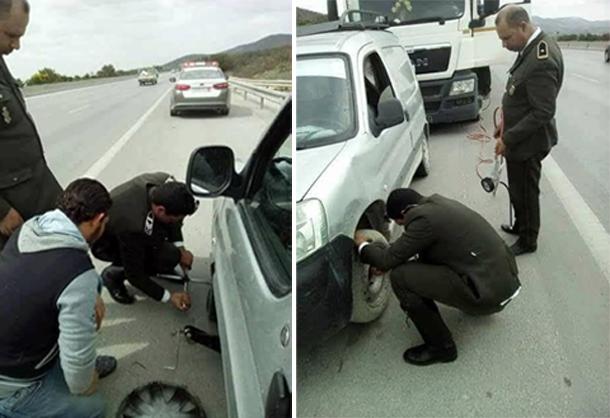 En photo : Les agents de la garde nationale aident un citoyen à changer la roue de sa voiture