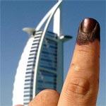 Photo du jour : Le doigt Bleu à Burj Al Arab et Burj Khalifa