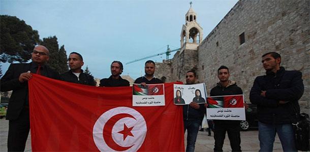 Des activistes palestiniens manifestent à Beit Lahm, en soutien à la Tunisie