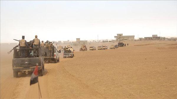 العراق يعلن فرض سيطرته الكاملة على بلدة اجتاحها داعش غربي البلاد