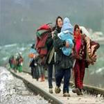 المهاجرون يبدأون بمغادرة مخيم 'كاليه' شمال فرنسا